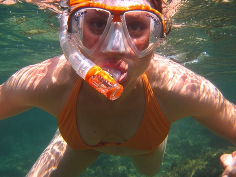 Woman in Orange Bikini Underwater With Snorkel