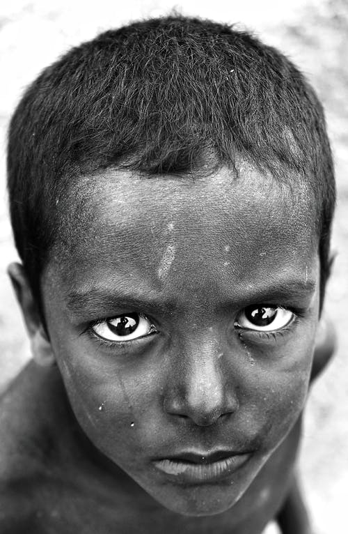 Focused black boy with deep gaze