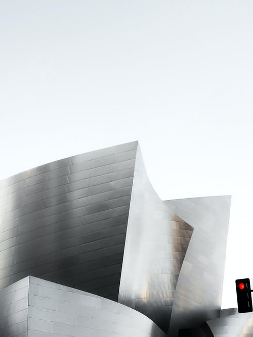 Gray Concrete Building Under White Sky