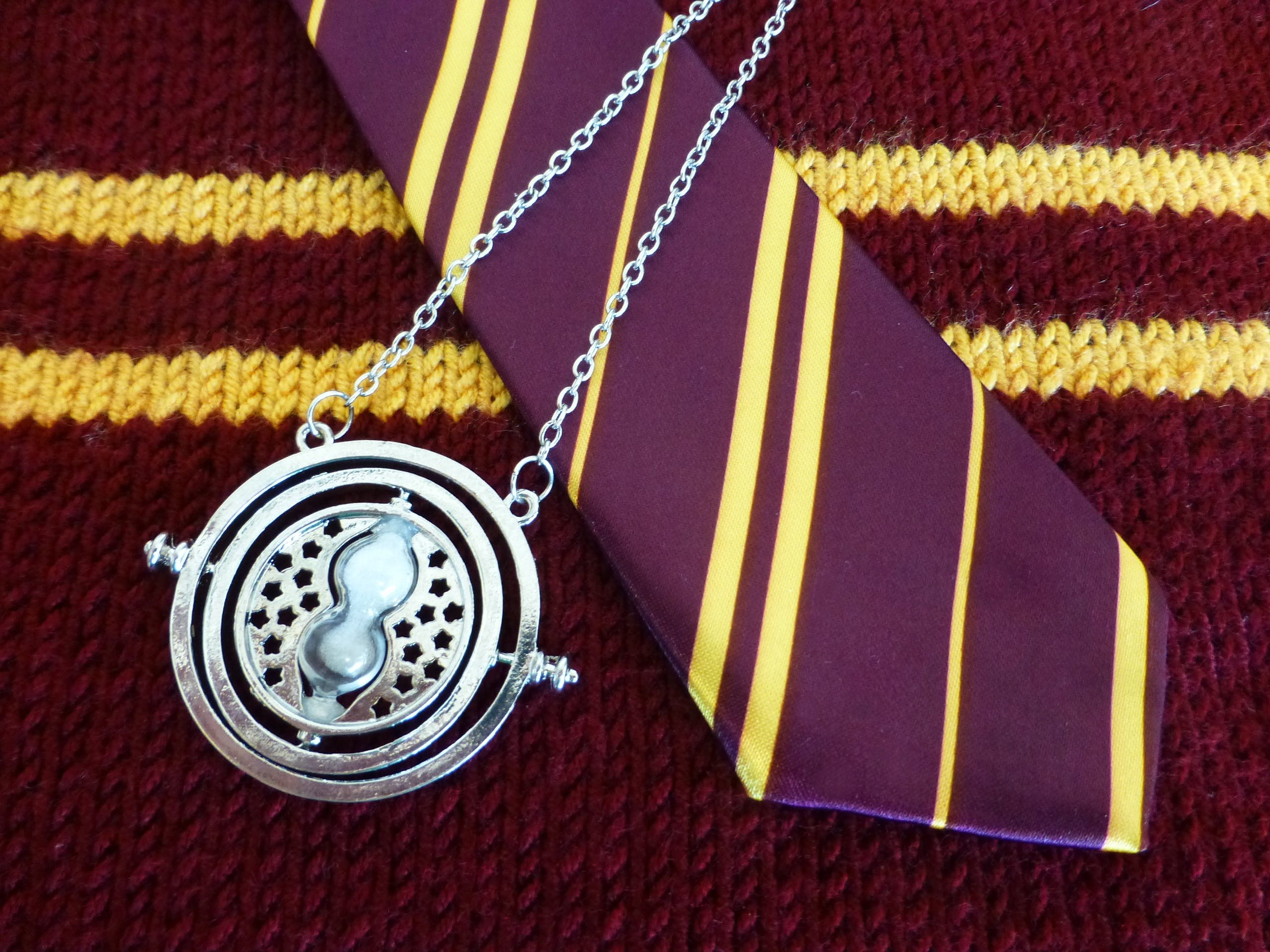 Silver-colored Necklace and Purple Necktie