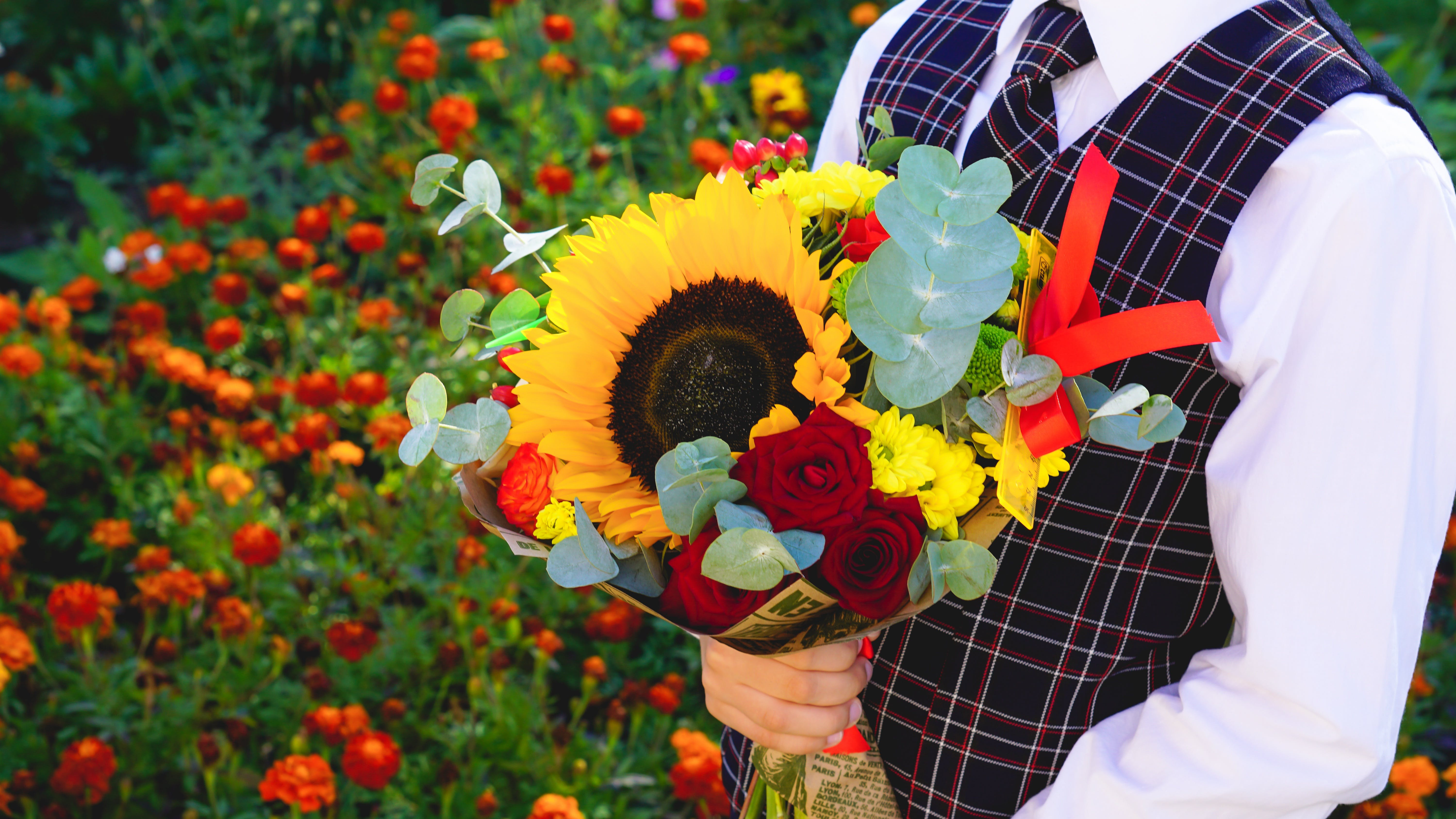 Person Holding Yellow Sunflower Bouquet