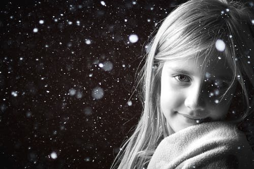 Girl Smiling during Snow