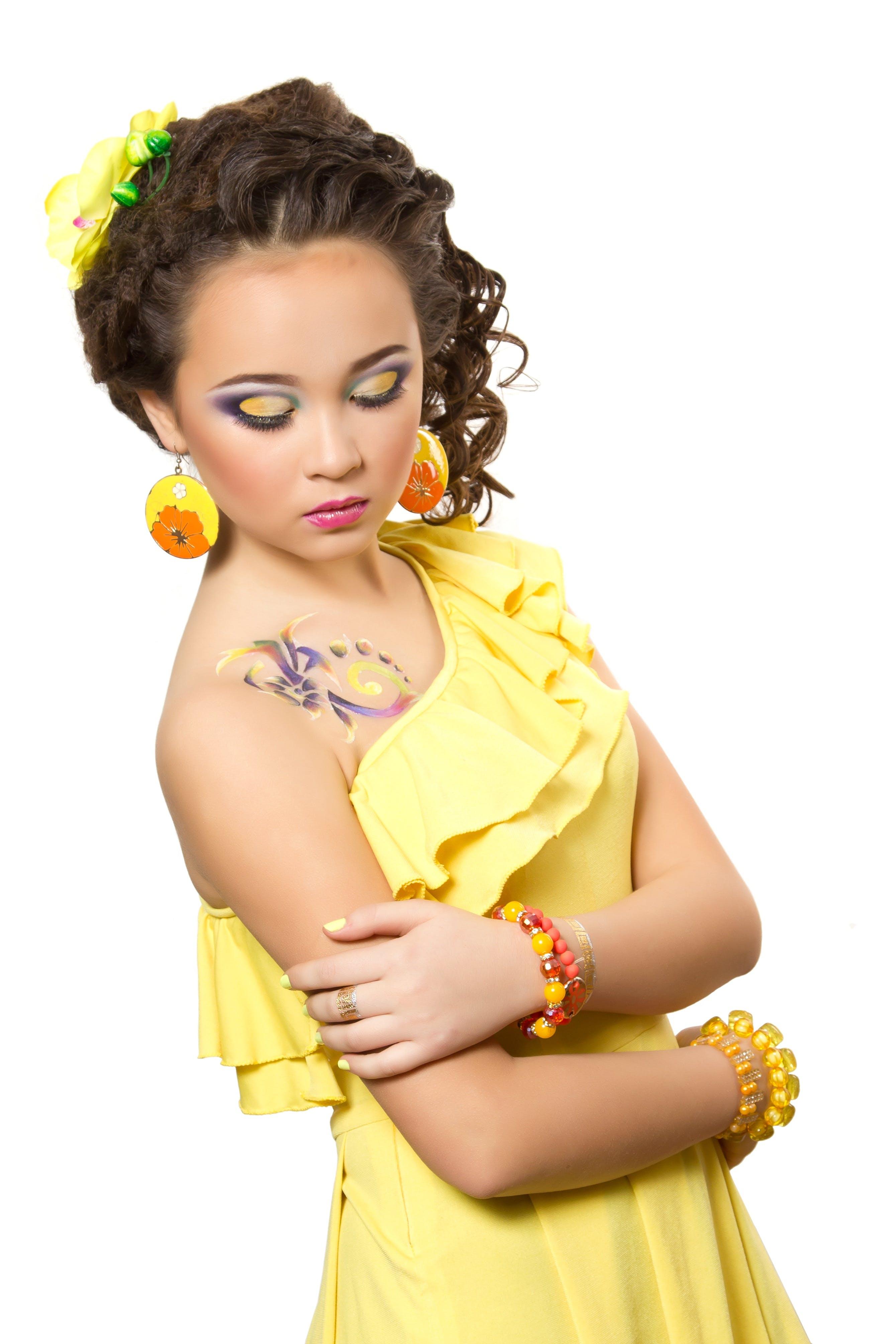 Free stock photo of girl, yellow, dress, hairstyle