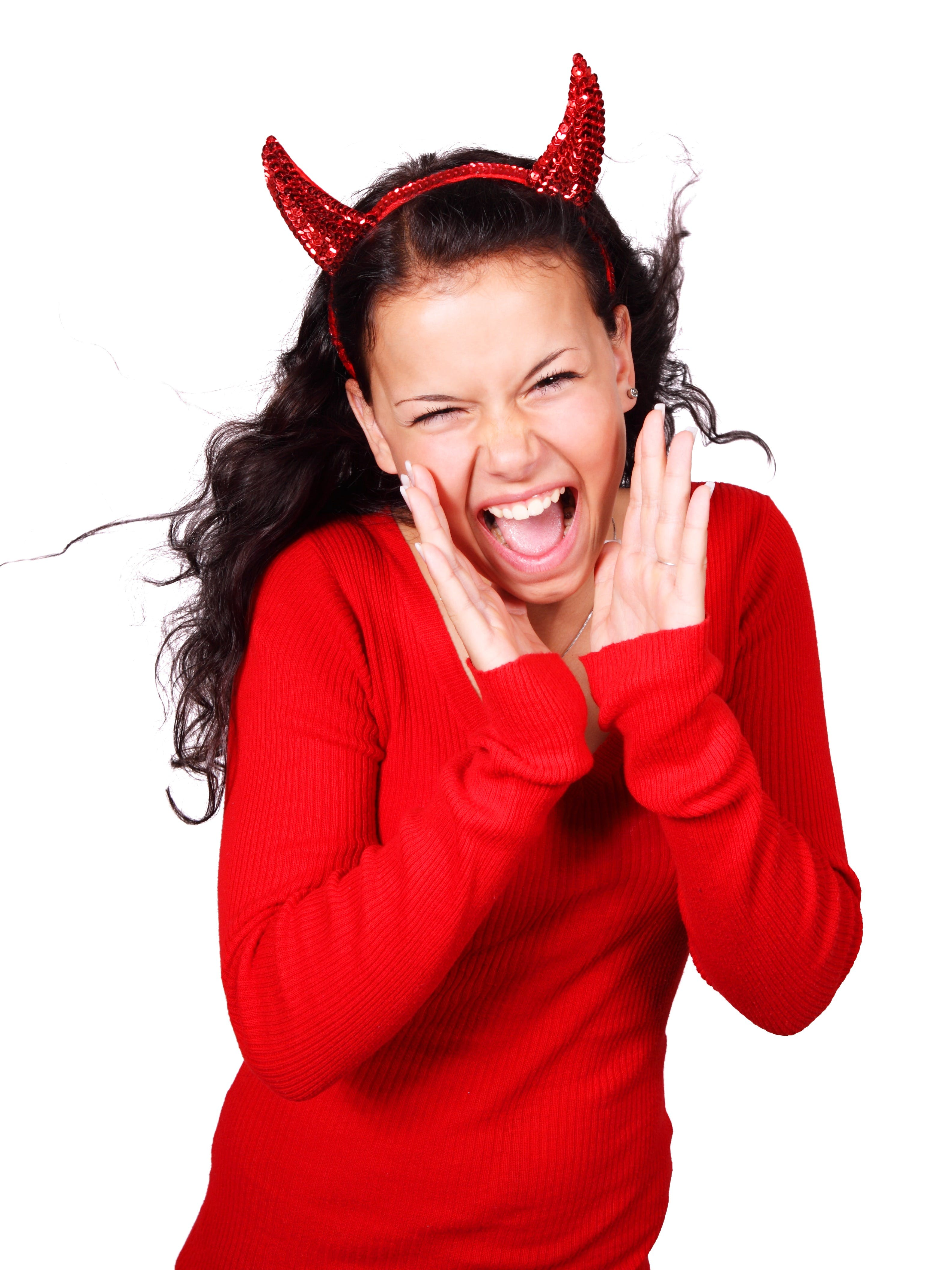 Shouting Woman Wearing Red Devil Horns Headband