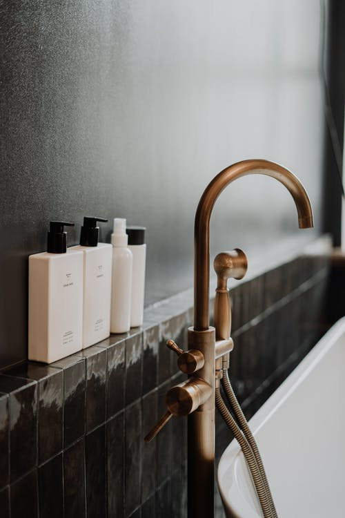 Brass Faucet With White Ceramic Bathtub