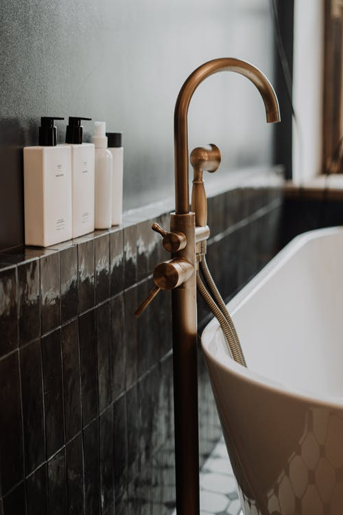 Stainless Steel Faucet on Bathtub