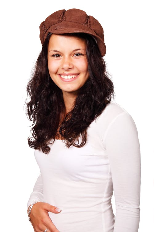 Woman Wearing Brown Cap and White Long Sleeve Shirt