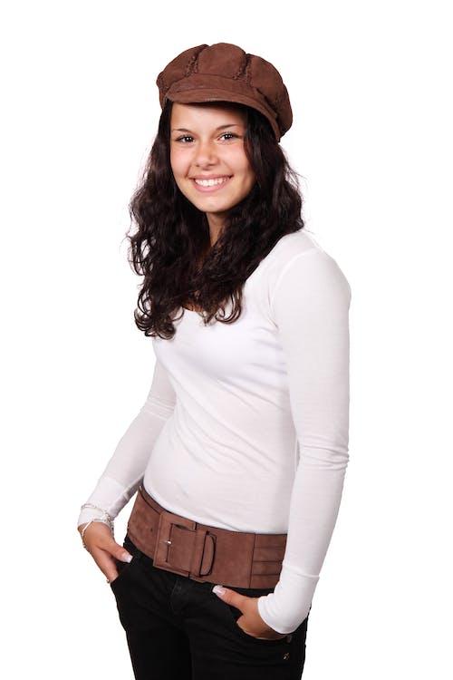 Girl in White Long Sleeve Shirt Wearing Brown Beret