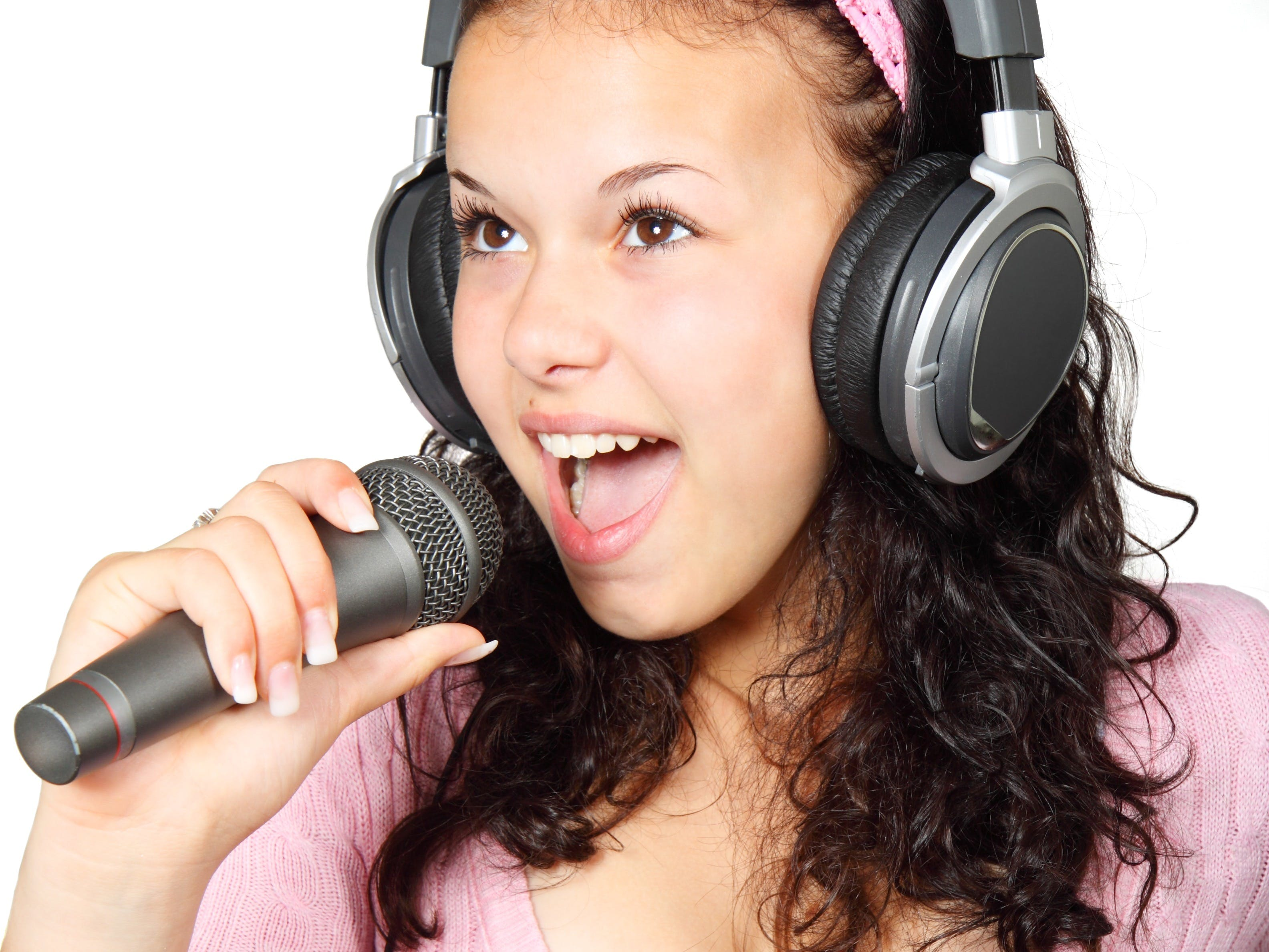 A Girl Holding a Microphone With a Headphone