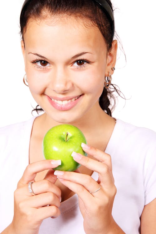 Smiling Woman Holding Green Apple Fruit