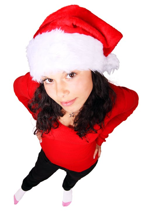 Woman Standing Wearing Red Scoop Neck Long Sleeve Shirt and Santa Cap