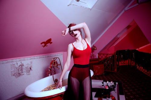 Woman Holding Bathtub