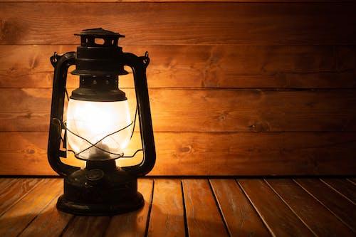 Black Lantern Lamp on Brown Wooden Floor