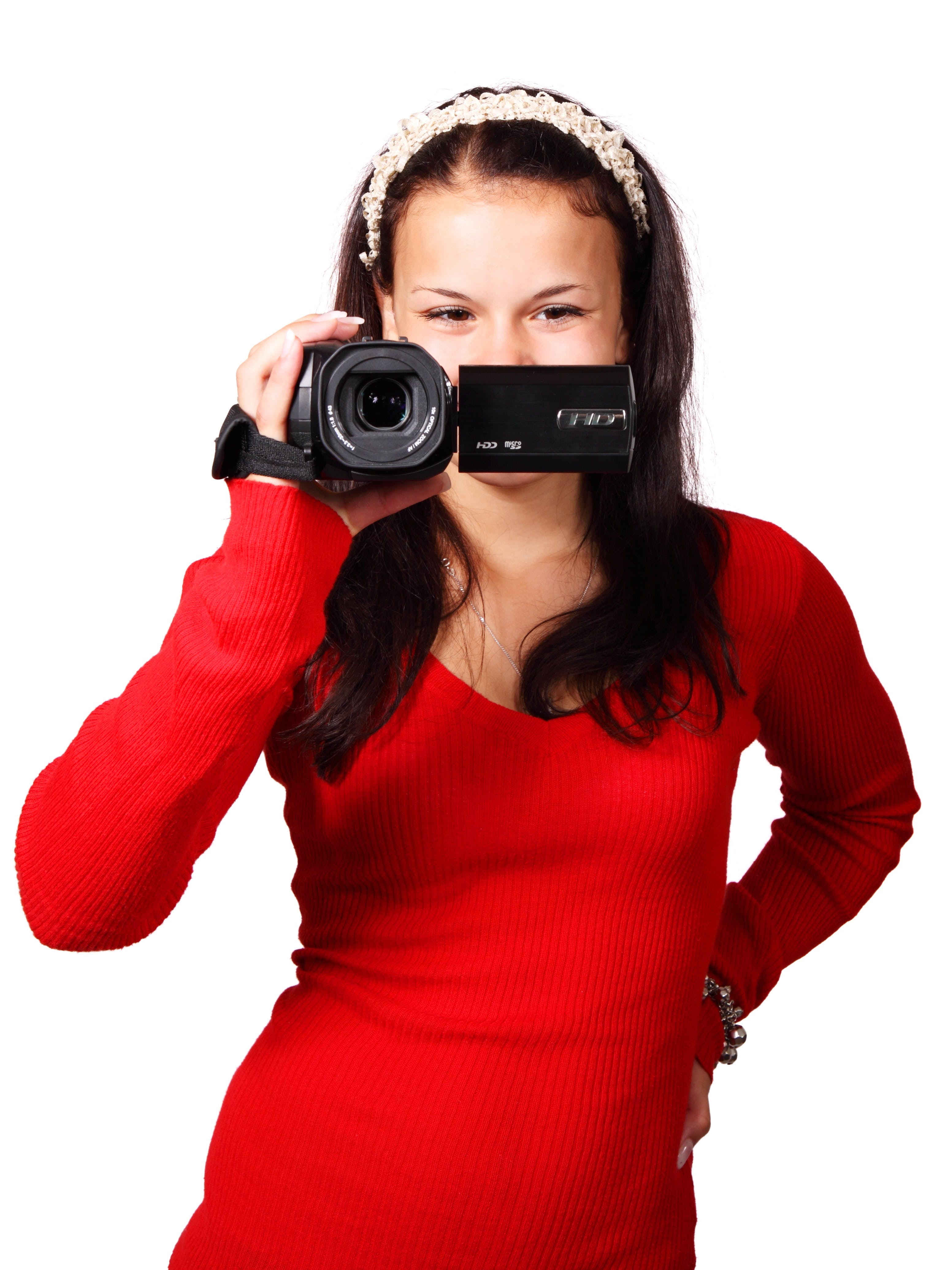 Woman Holding a Black Video Camera