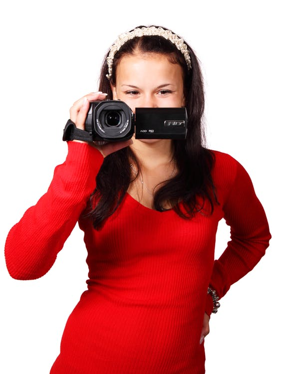 Woman Holding a Black Video Camera