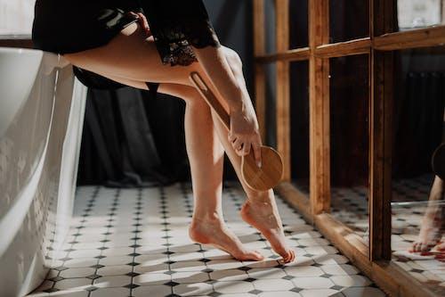 Woman in Black Skirt and White Shirt Kneeling on Floor