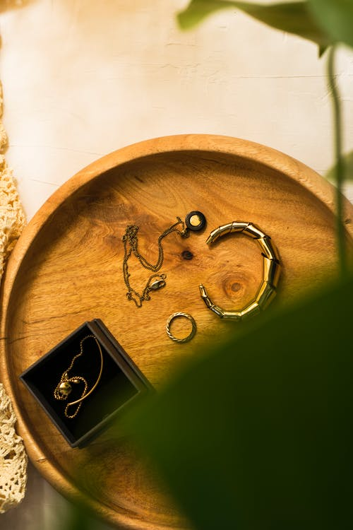 Gold and Silver Rings on Round Wooden Table