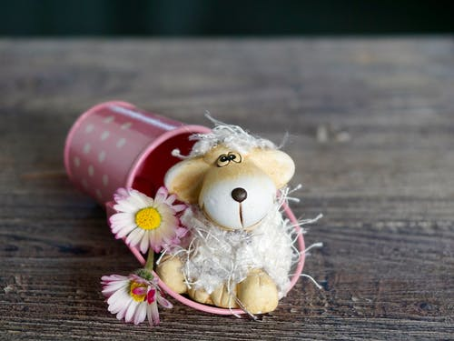 Brown Mouse Toy Beside Pink Basket