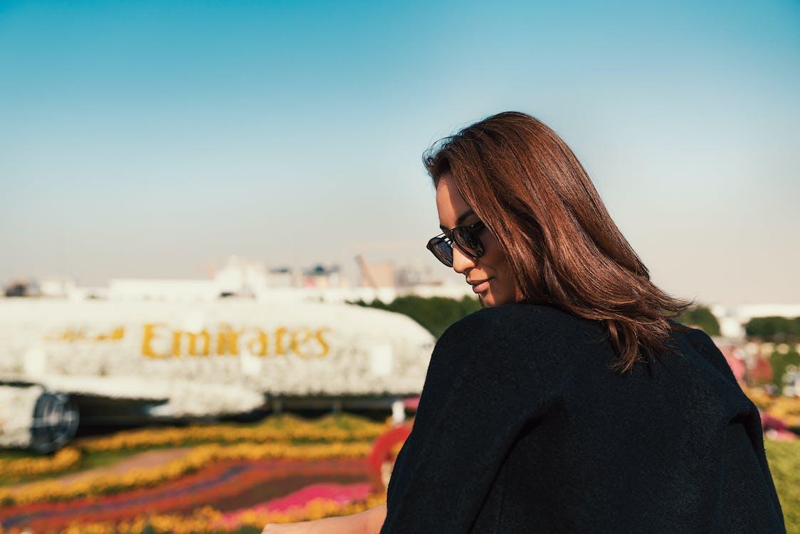 Woman in Black Long Sleeve Shirt Wearing Black Sunglasses