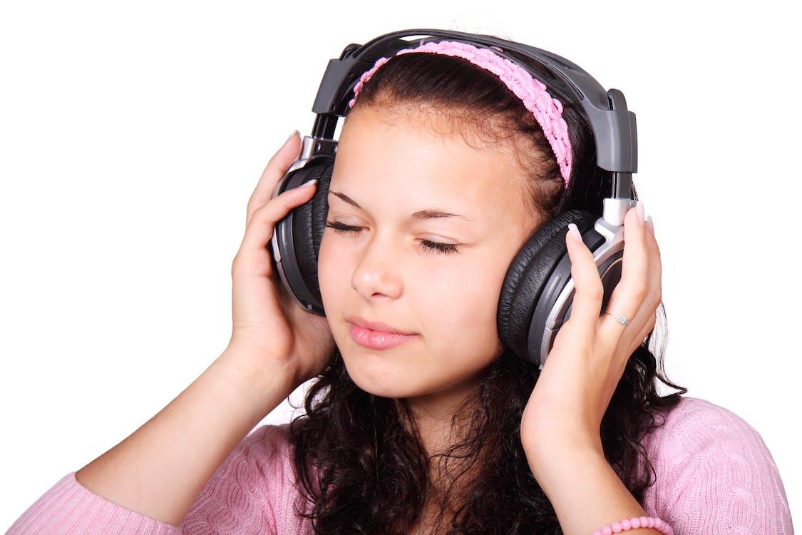 Woman Wearing Black On-ear Headphones