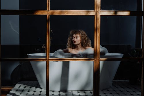 Woman in Bathtub With Water