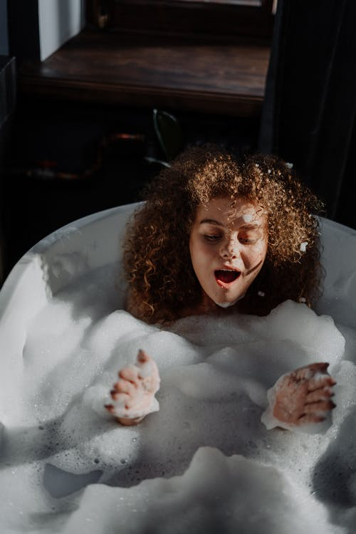 Girl in Bathtub With Water