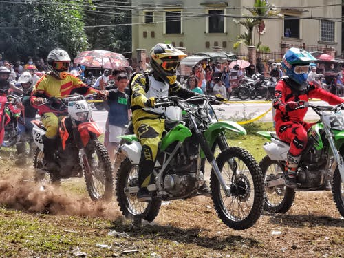 Bikers on motorcycles during competition in city
