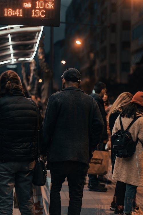 Man in Black Jacket Standing Beside Woman in Black Jacket