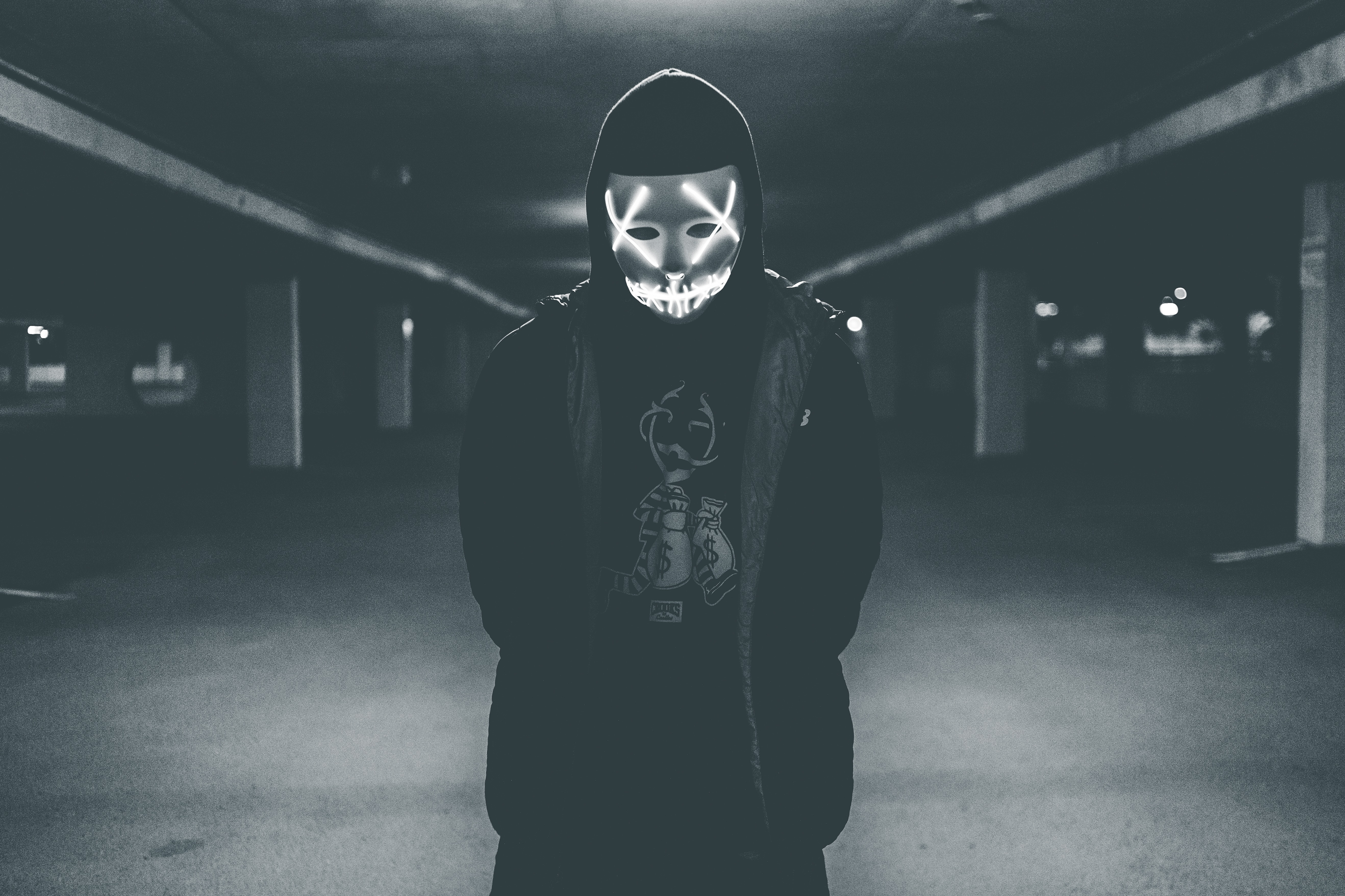 Man Wearing Hood And Mask With Neon Lights Free Stock Photo