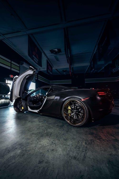 Black Ferrari 458 Italia Parked in Garage