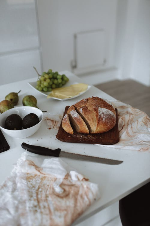 Bread on Brown Wooden Chopping Board