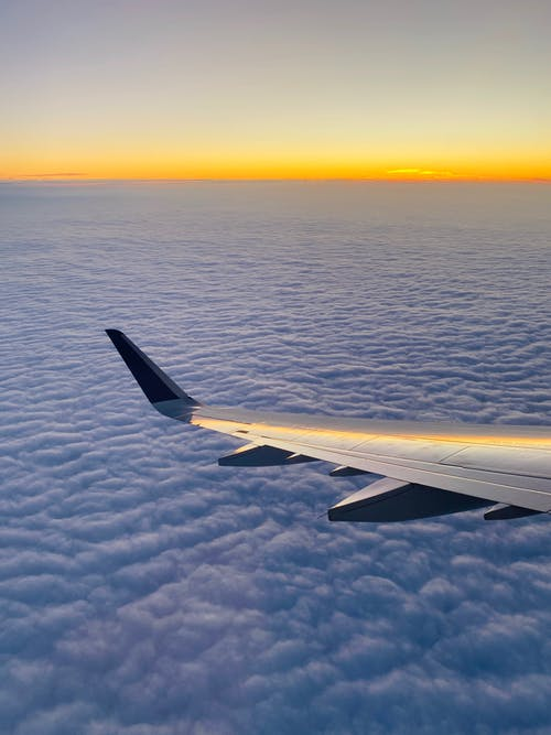 Free stock photo of airplane, clouds, sunrise, wing