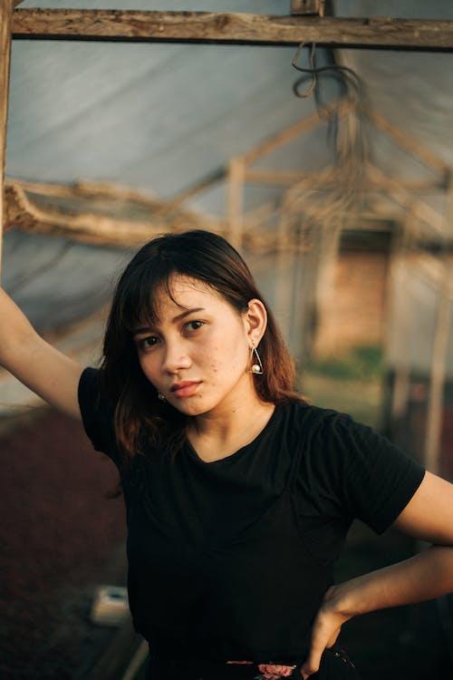 Close-Up Shot of a Pretty Woman in Black Shirt Posing while Looking at Camera