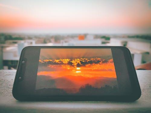 Free stock photo of cell phone, meeting sunrise, sunrise, Sunrise - Dawn