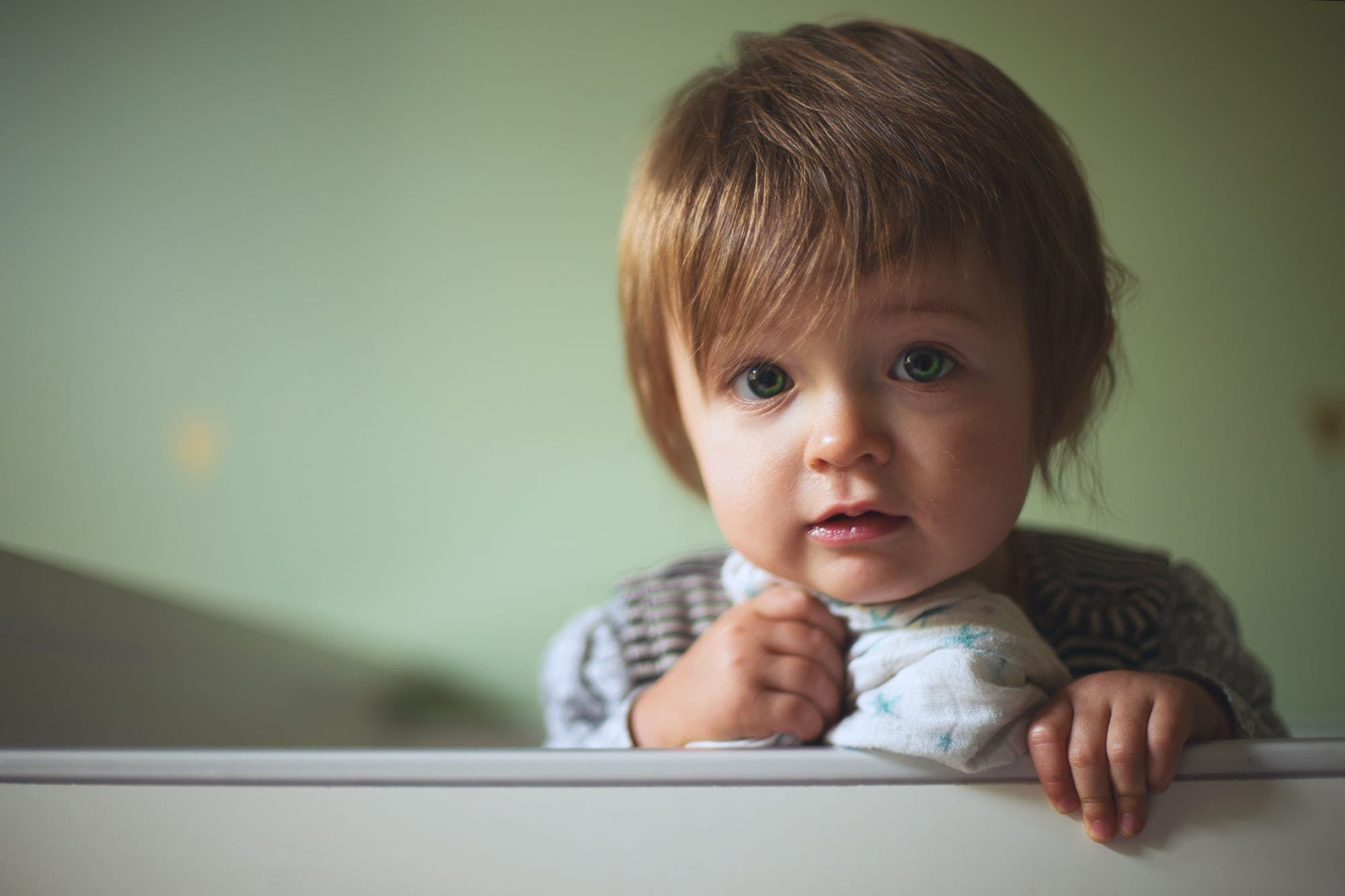 Toddler's Leaning on White Wall