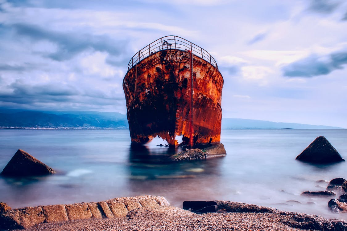 Rusted Boat on Body of Water