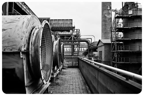 Gray Scale Photography of Industrial Machine