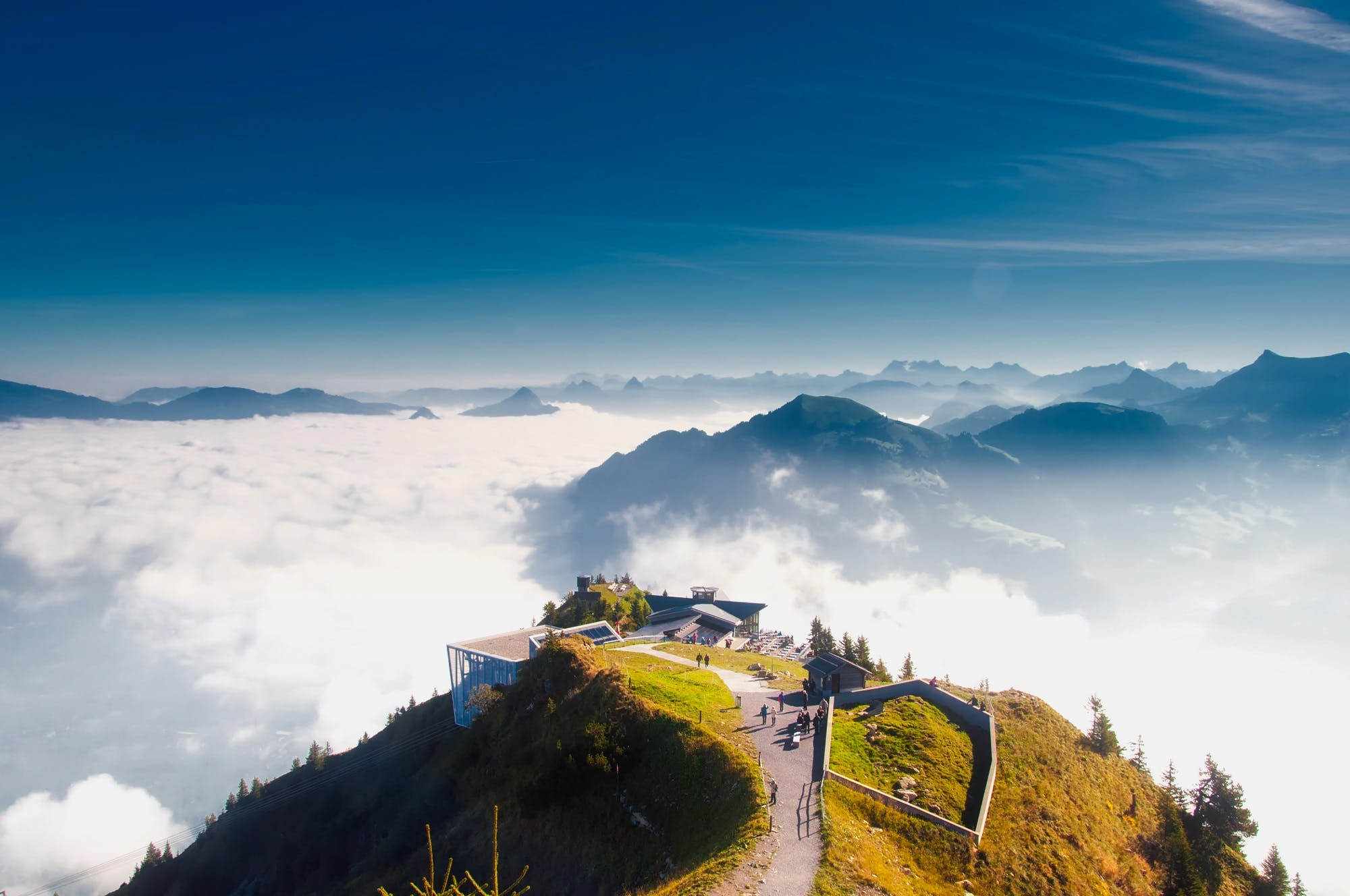 Birds Eye View of House on Hill over White Clouds