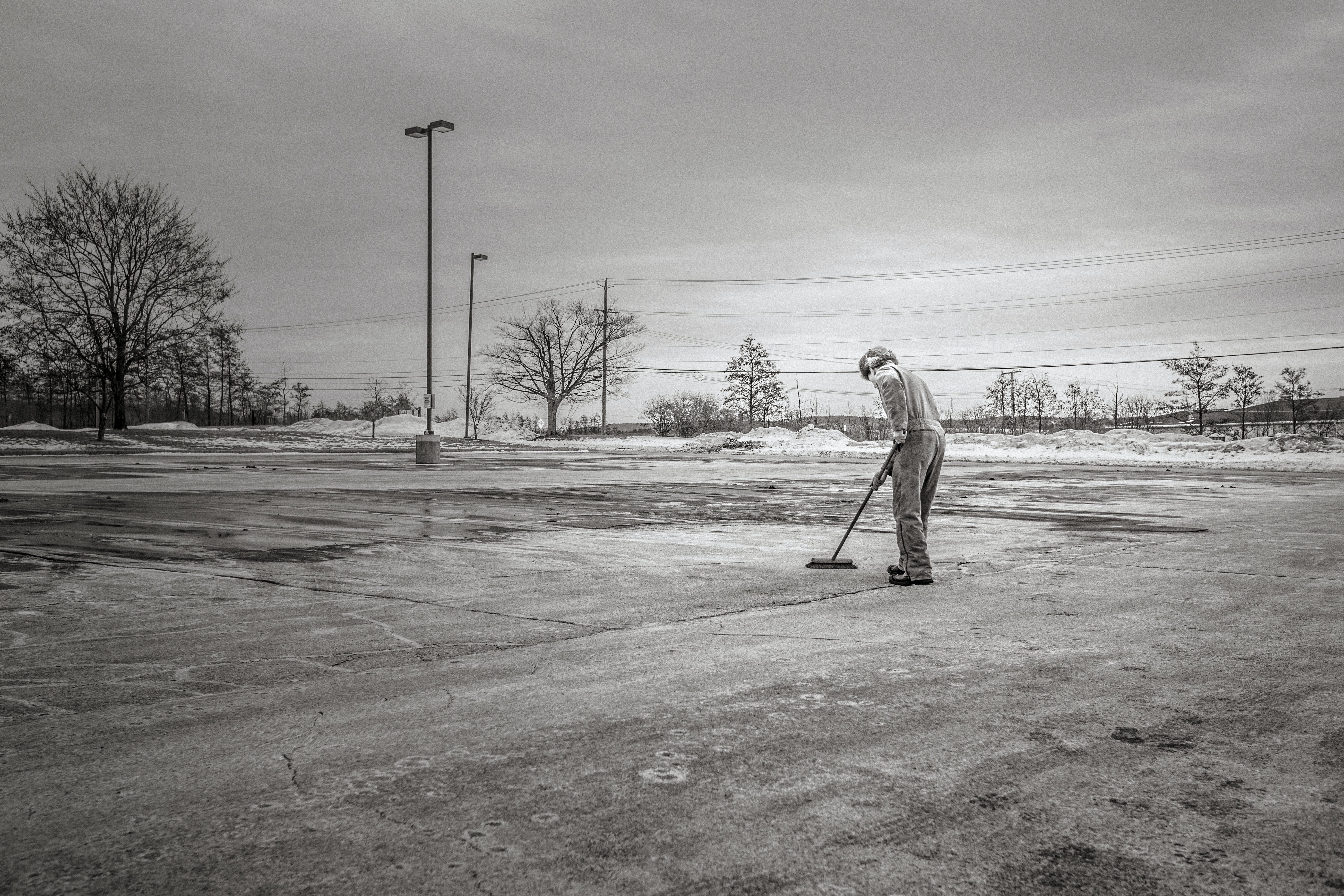 Person Sweeping Pavement