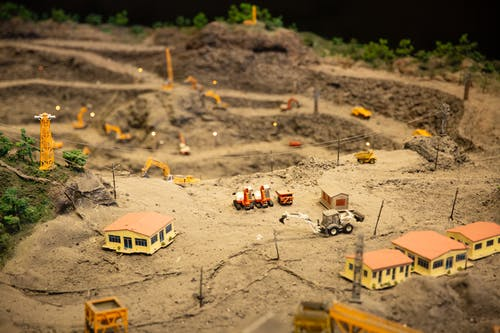 Miniature construction site with various equipment