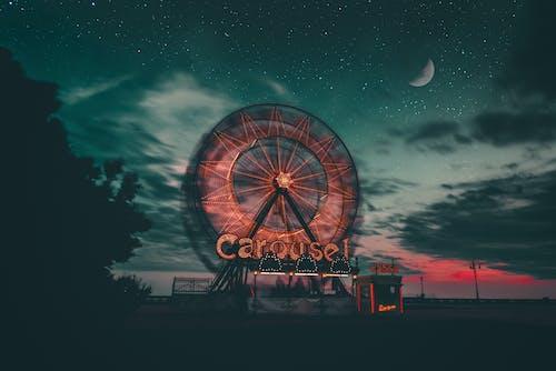 Silhouette of Ferris Wheel Under Starry Night