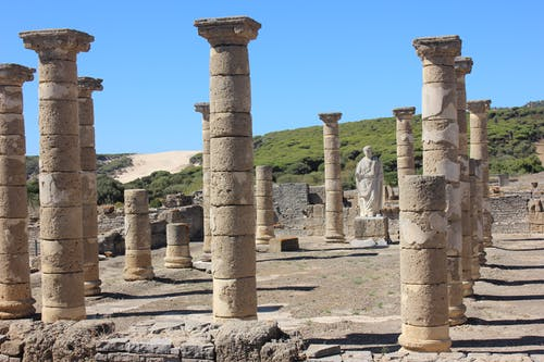Ancient basilica with ruined columns in sunlight