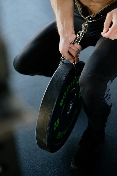 Person Chained to a Weight