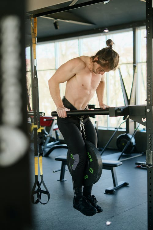 Topless Man in Black Pants Exercising