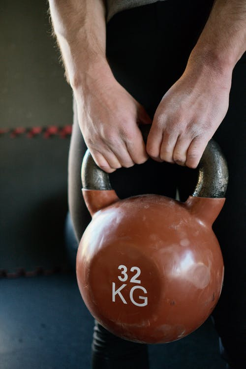 Person Holding a Kettlebell
