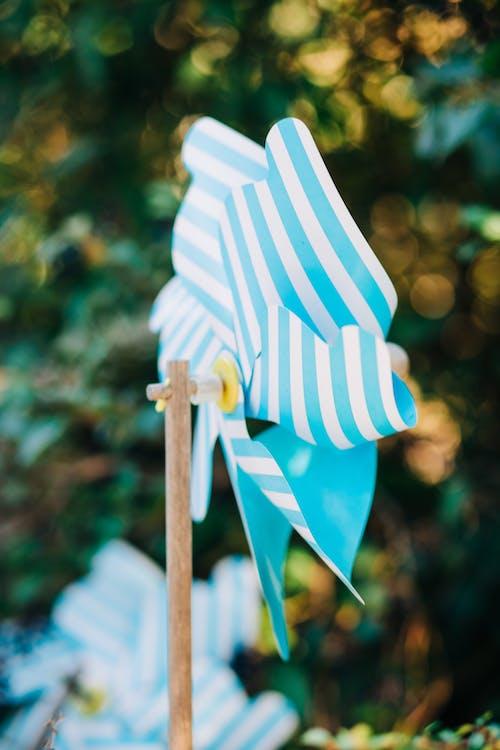 Striped paper windmill in garden