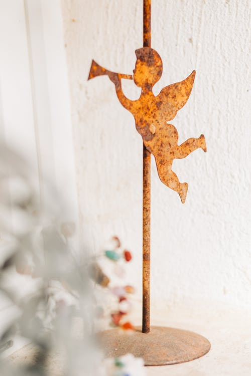 Brown Star Ornament on White Wall