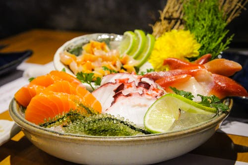 Served cold sashimi with herbs and condiments