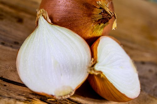 White Garlic on Brown Wooden Surface