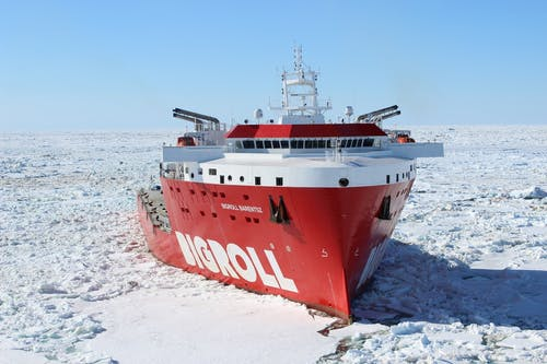 Red and White Bigroll Cruise Ship Surrounded by Snow
